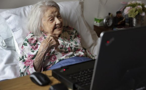 Patient Louise Irving watches
