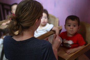 A Costa Rican son or daughter enjoys meals with a tasks overseas volunteer