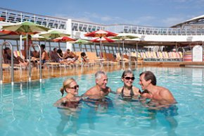an adult and more youthful few swim together in a cruise ship share