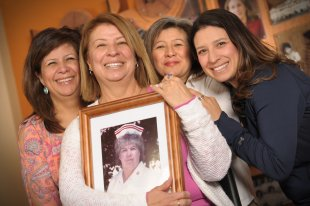 set of women holding a framed photo